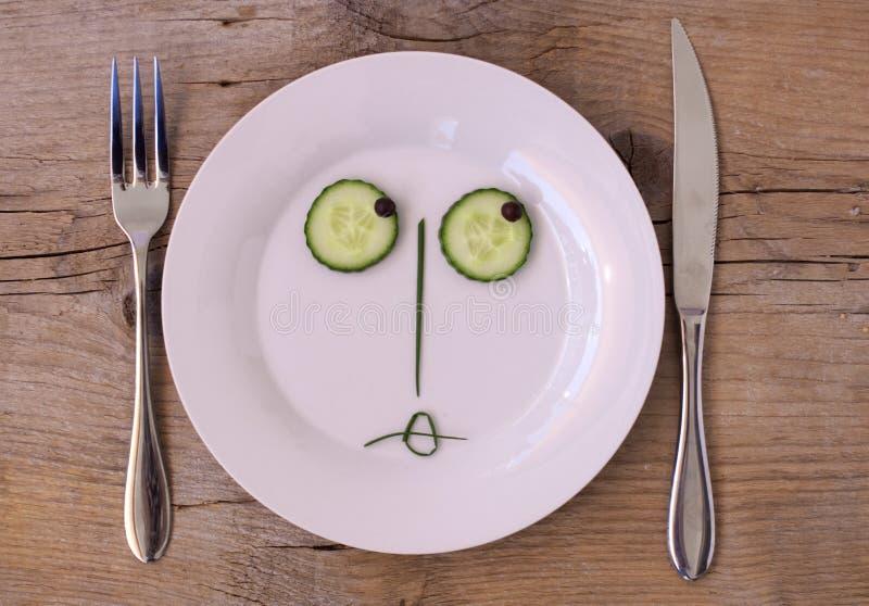 Vegetable Face on Plate - Female, sulking stock photography
