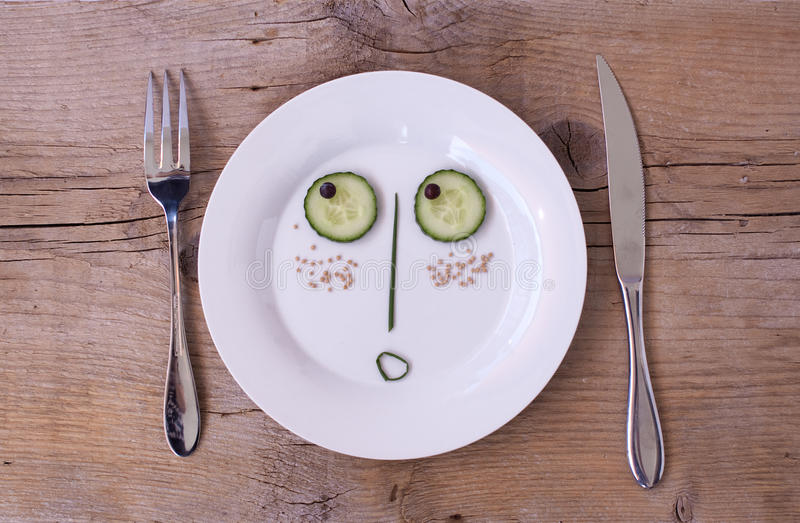 Vegetable Face on Plate - Male, Surprised royalty free stock photography
