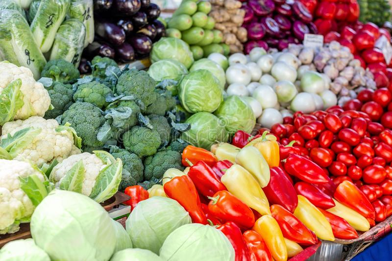 Vegetable farmer market counter. Colorful heap of various fresh organic healthy vegetables at grocery store. Healthy. Natural food background royalty free stock photography