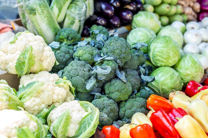 Vegetable farmer market counter. Colorful heap of various fresh organic healthy vegetables at grocery store. Healthy natural food stock image