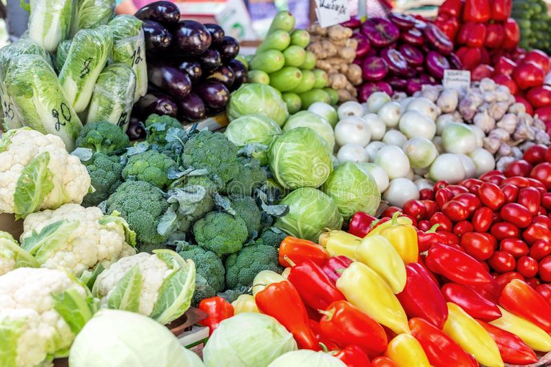 Vegetable farmer market counter. Colorful heap of various fresh organic healthy vegetables at grocery store. Healthy natural food royalty free stock photo