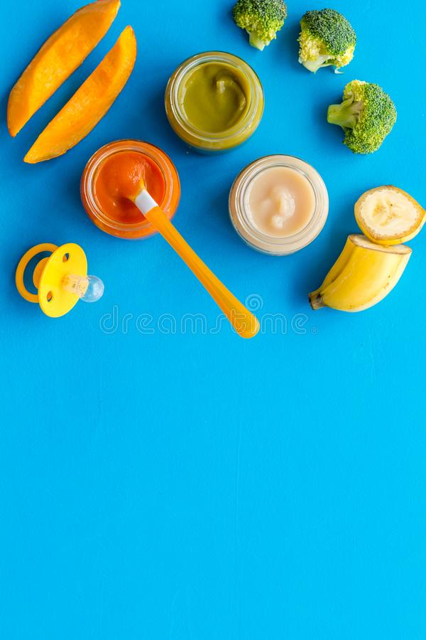 Vegetable and fruits puree for feed babies on blue background top view copy space. Vegetable and fruits puree for feed babies on blue background top view stock photos