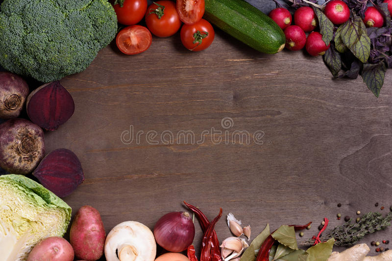 Vegetable ingredients on cooking board, organic healthy food menu. Top view, copy space. royalty free stock photo