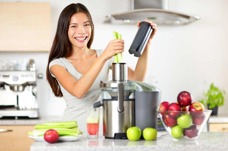 Vegetable juice raw food - healthy juicer woman. Vegetable juice raw food - healthy eating woman with juicer juicing green vegetables and apple fruits as part of