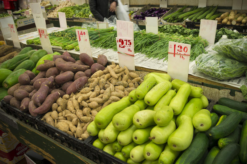 Vegetable market in new york. Various types of oriental vegetables on a market in chinatown, new york stock image