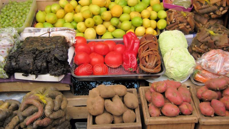 Vegetable Market stall with tomatoes, potatoes, lemons. Market stall with various colored vegetables with tomatoes, potatoes, lemons, carrots, seaweed, Argentina royalty free stock images