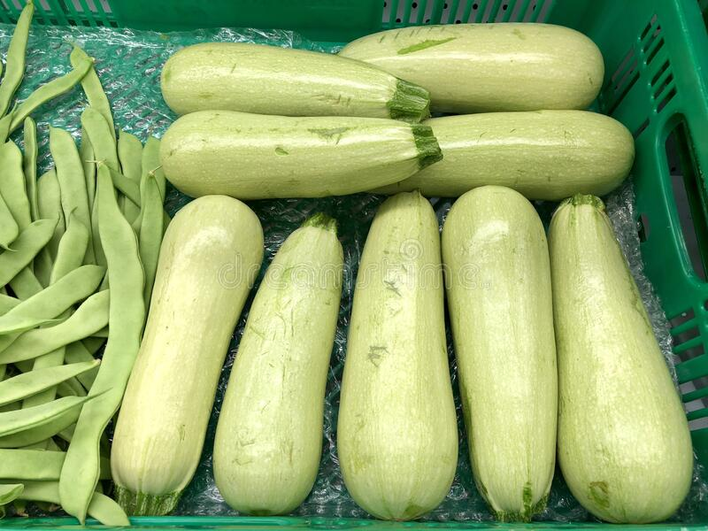 Vegetable marrow, peas, food and retail concept royalty free stock photo