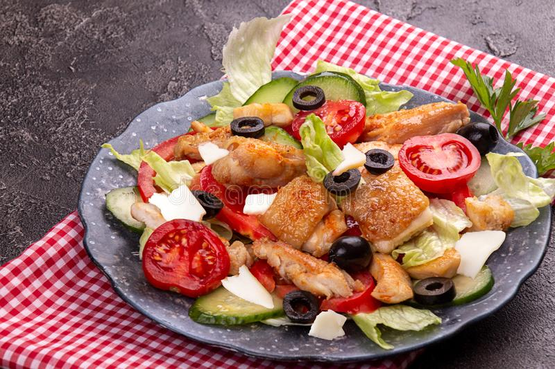 Vegetable and meat salad of mozzarella, cheese, olives, chicken, cucumber, tomatoes. Low carb dietary food. Top view royalty free stock image