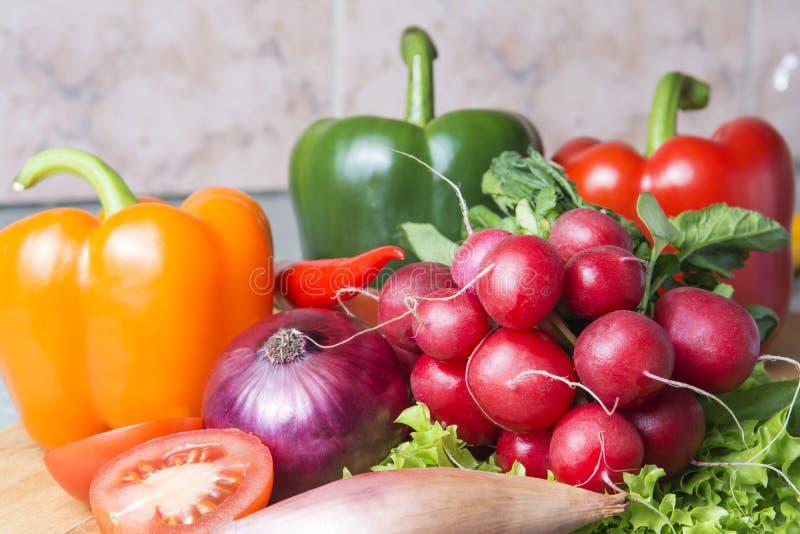 vegetable mix the kitchen. Radish, tomato, red paprika, green paprika, yellow paprika, red hot chili pepper, yellow hot chili stock images