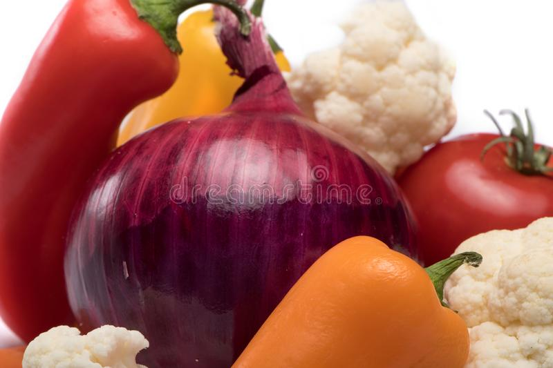 Vegetable Mix for salad on white background.  tomatoe, cauliflower, carrots, onion and peppers. Health Concept royalty free stock photography