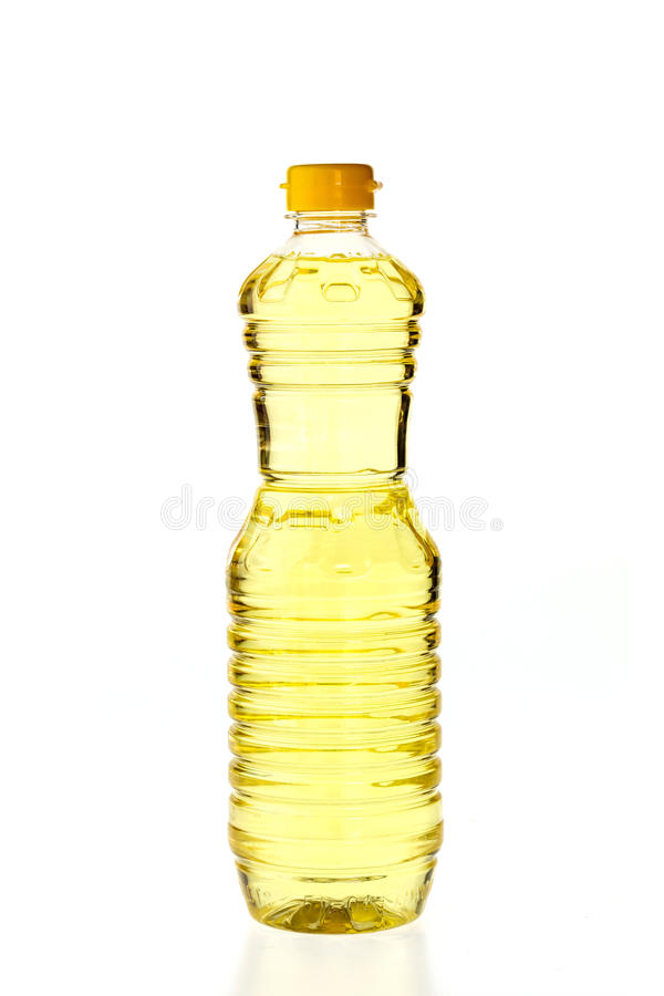 Vegetable oil for cooking in a bottle isolated on white. Background royalty free stock photography