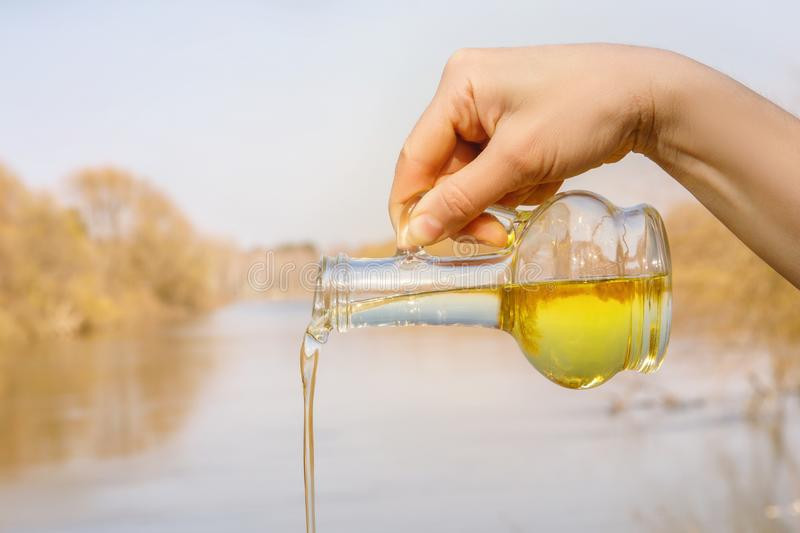 Vegetable oil poured out of the bottle . royalty free stock photos