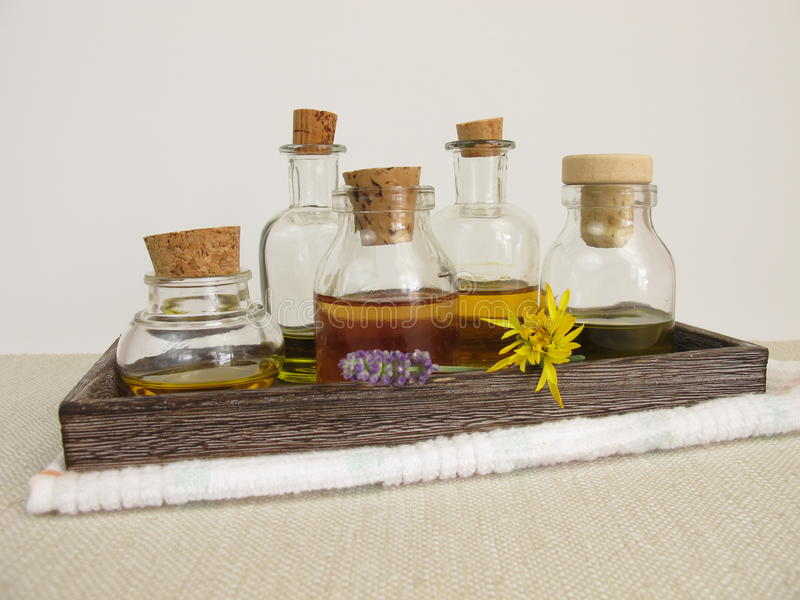 Vegetable oils for the skin care in bottles. On a tray stock image