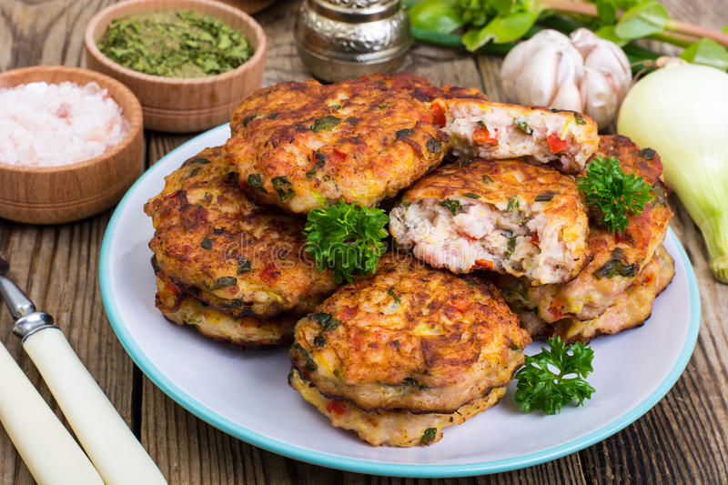 Vegetable pancakes with chicken meat stock photo