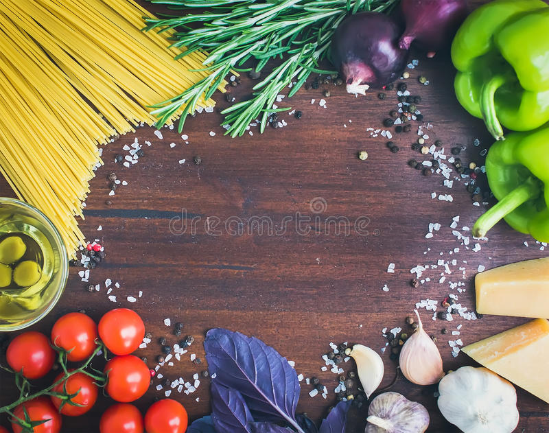 Vegetable pasta ingredients: spaghetti, peppers, tomatoes, basil royalty free stock photography