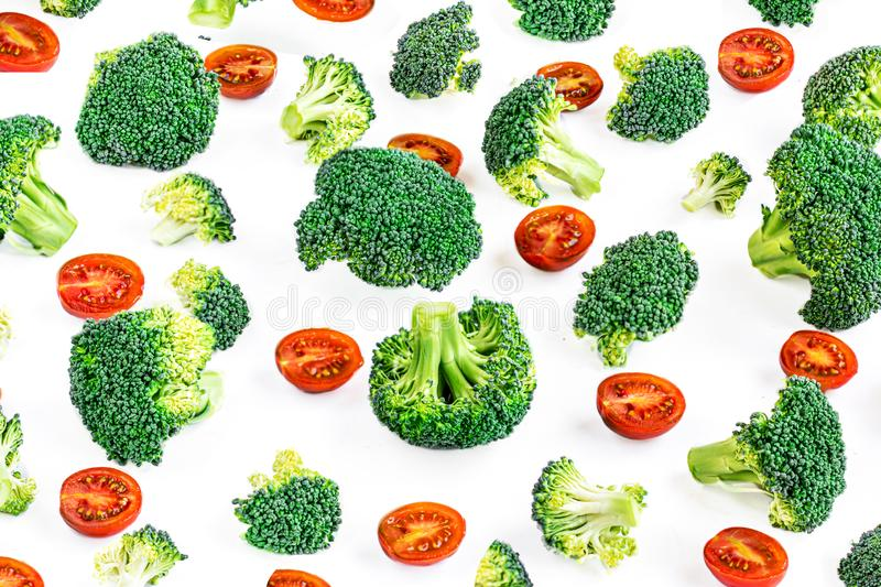 Vegetable Pattern with green  Broccoli and red tomatoes. Creative layout made of broccoli. Healthy Food Concept.  Flat lay.  stock photos