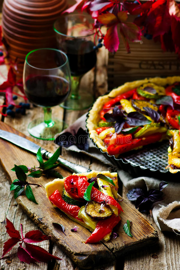 Vegetable pie ratatouille. On a wooden board. Style rustic. selective focus royalty free stock photography