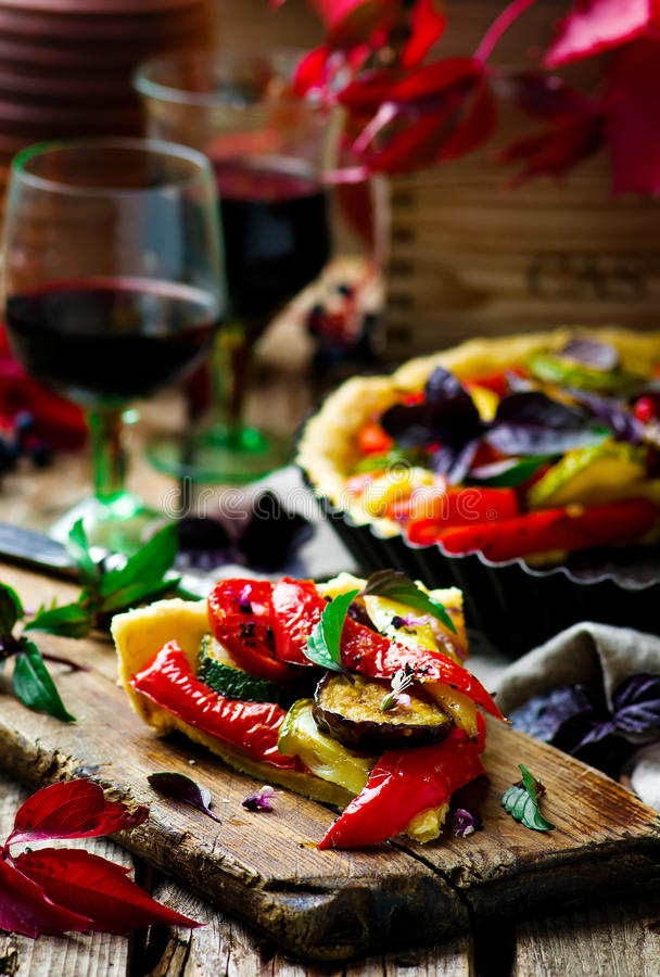 Vegetable pie ratatouille. On a wooden board. Style rustic. selective focus royalty free stock photos