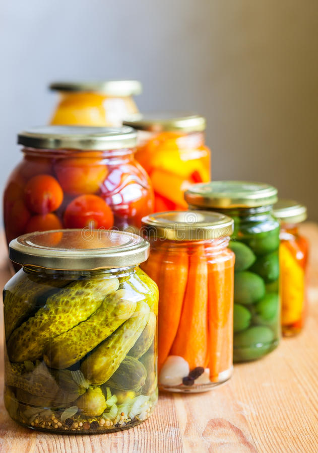 Vegetable preserves. On wooden table royalty free stock photos