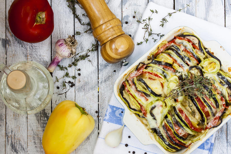 Vegetable ratatouille with cheese and thyme. Vegetable ratatouille with eggplant, zucchini, tomatoes, cheese and thyme stock image