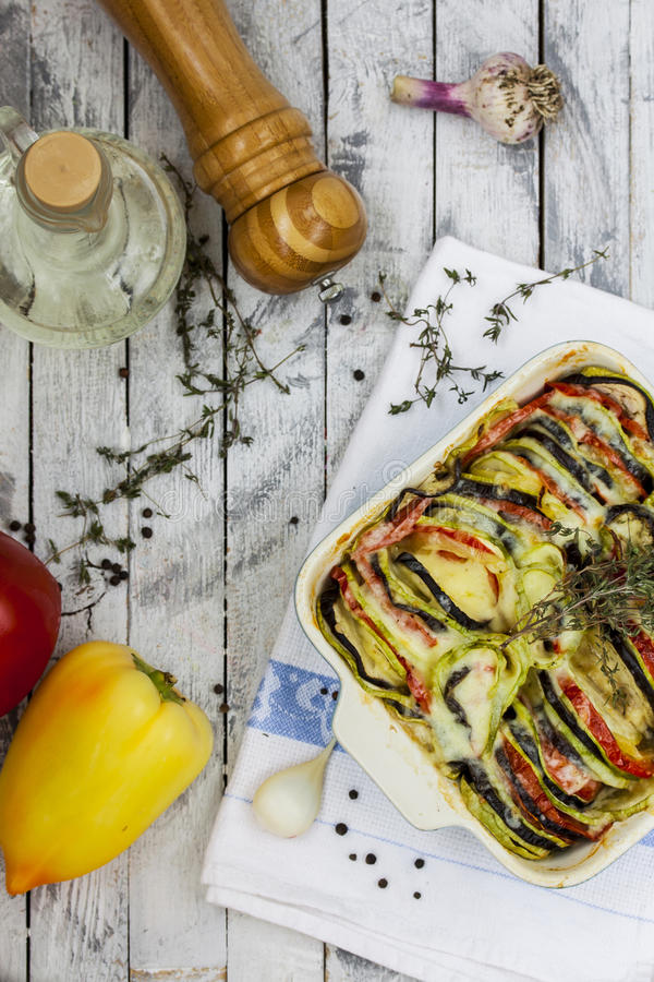 Vegetable ratatouille with cheese and thyme. Vegetable ratatouille with eggplant, zucchini, tomatoes, cheese and thyme royalty free stock photos