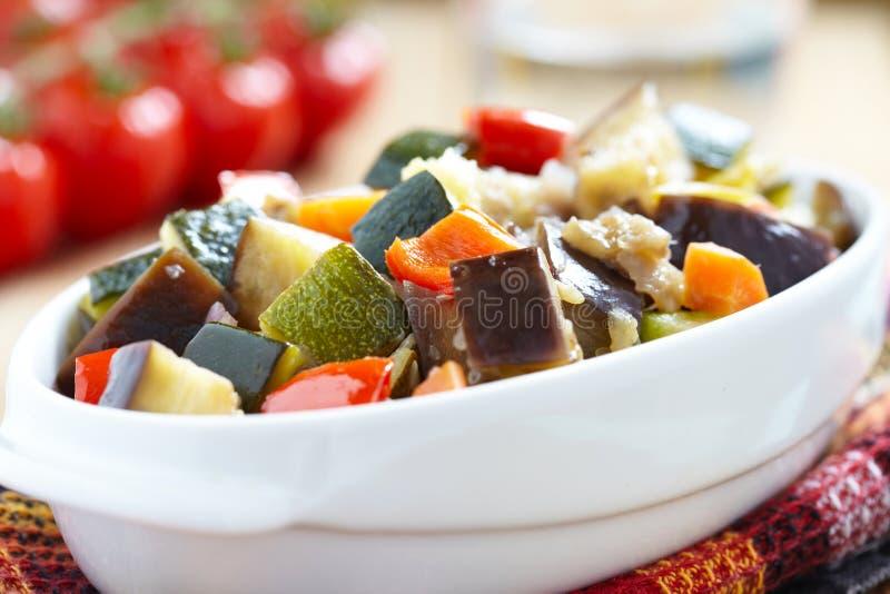 Ratatouille. Vegetable ratatouille on wooden table royalty free stock image