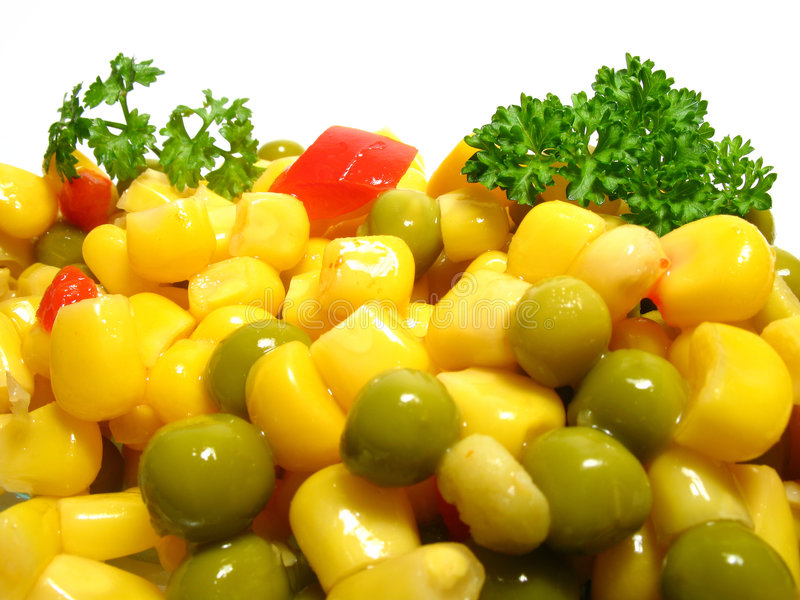 Vegetable salad. Detail fresh vegetable salad with peas, corn and paprika stock photos