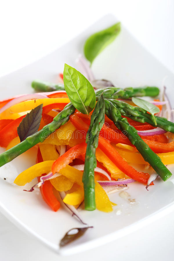 Vegetable salad with asparagus and pepper stock image