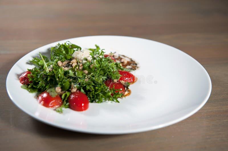Vegetable salad beans, tomatoes, arugula stock photography