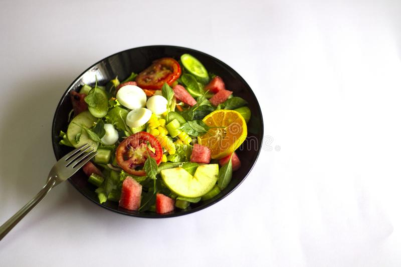 Vegetable salad on a black plate Weight loss concept Healthy food royalty free stock photos