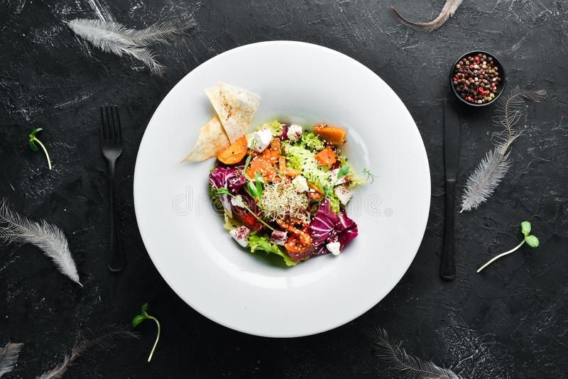 Vegetable salad with cabbage with feta cheese. In the plate. Top view. Free space for your text. Rustic style royalty free stock images
