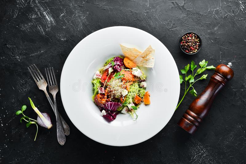 Vegetable salad with cabbage with feta cheese. In the plate. Top view. Free space for your text. Rustic style royalty free stock photo