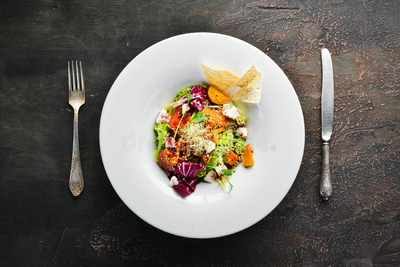 Vegetable salad with cabbage with feta cheese. In the plate. Top view. Free space for your text. Rustic style royalty free stock photos