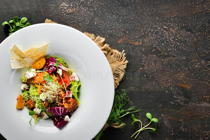 Vegetable salad with cabbage with feta cheese. In the plate. Top view. Free space for your text. Rustic style royalty free stock image