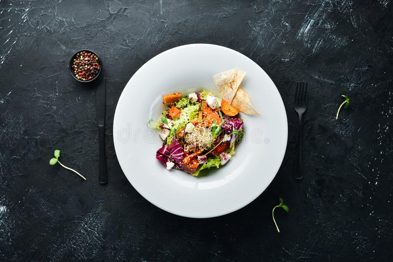 Vegetable salad with cabbage with feta cheese. In the plate. Top view. Free space for your text. Rustic style stock images