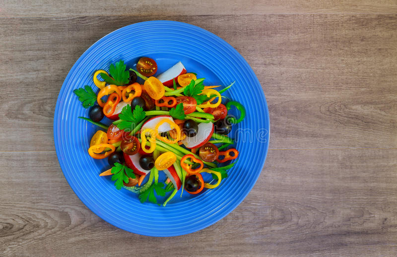Vegetable salad with fresh lettuce, tomatoes, cucumber and carrot in glass royalty free stock images