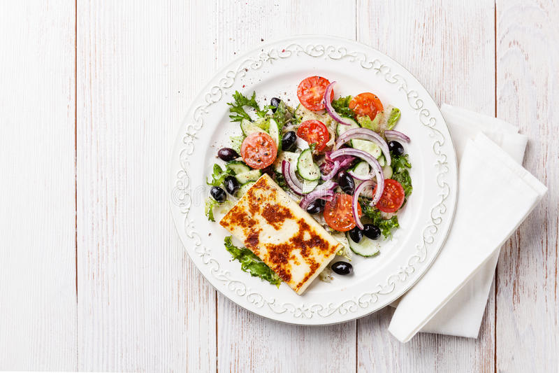 Vegetable salad with grilled cheese stock photos