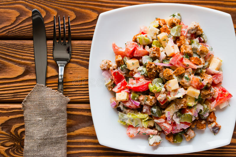 Vegetable salad with mayonnaise in white plate royalty free stock photography