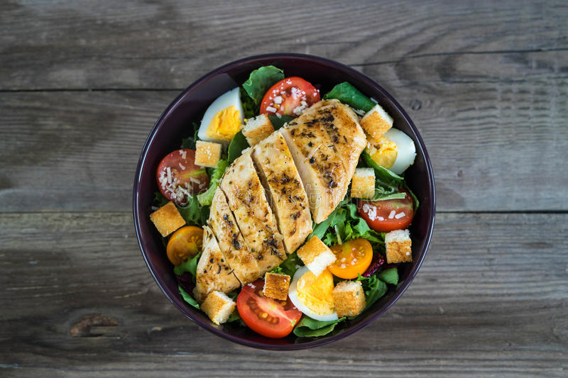 Vegetable salad with roasted chicken meat stock image