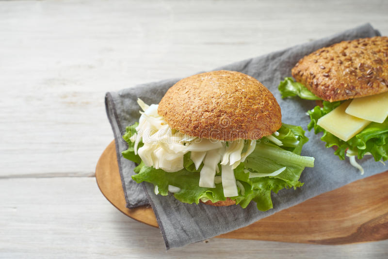 Vegetable sandwiches on the white wooden table stock photography