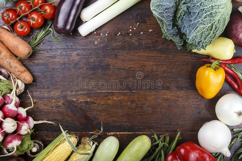 Fresh vegetables on a wooden background royalty free stock image