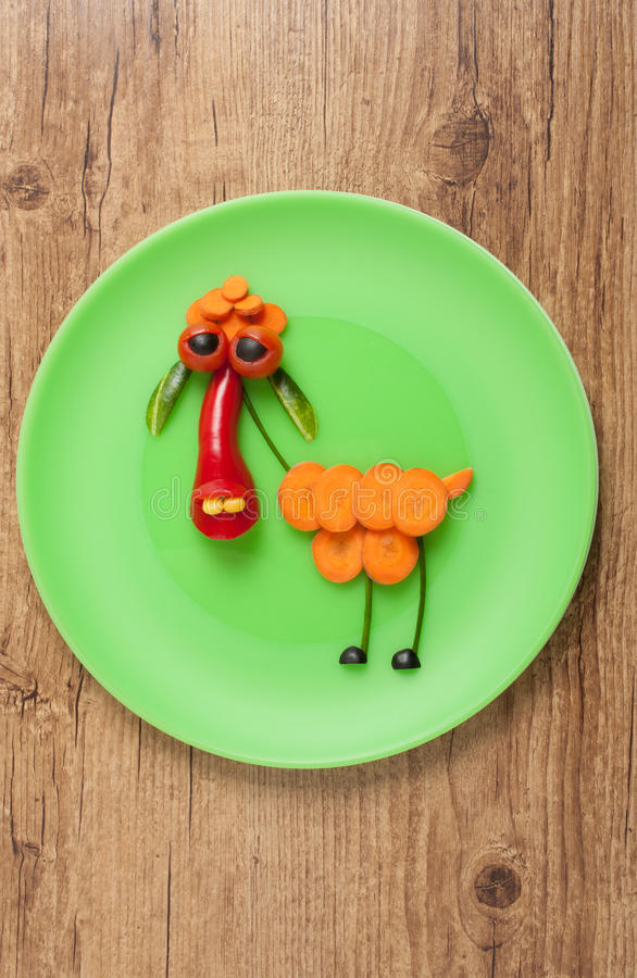 Vegetable sheep on green plate. On wooden background stock image
