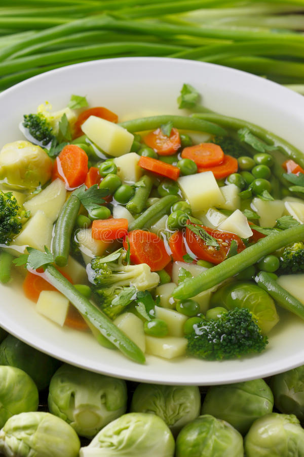 Vegetable soup. Diet vegetable soup,brussels sprouts and chives royalty free stock photos