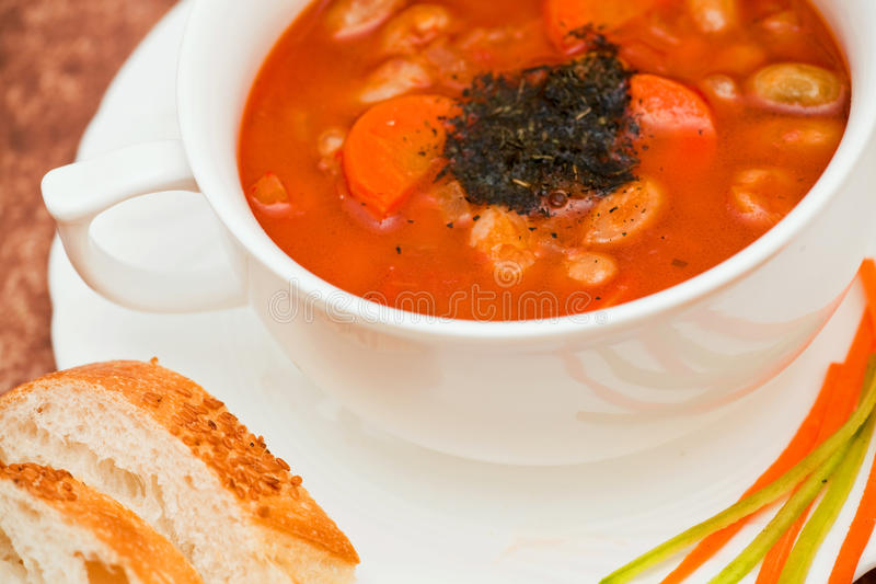 Vegetable soup. Close up, with bread and olive stock image