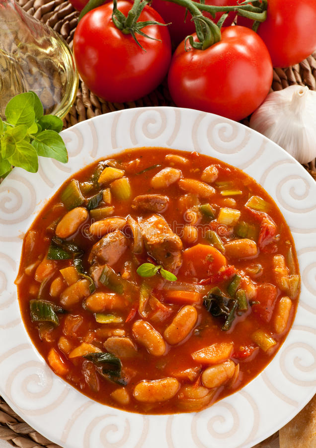 Vegetable soup. Bean, carrot, tomatoes royalty free stock photo