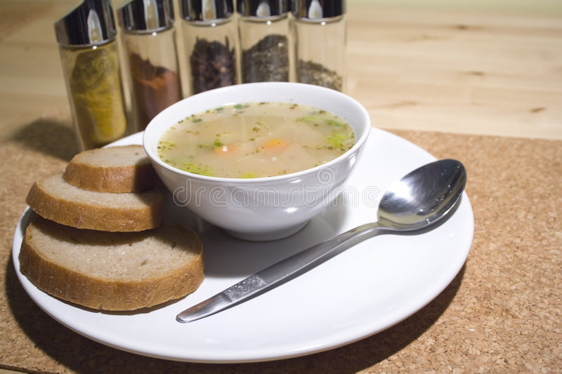 Vegetable soup. Fresh vegetable soup with bread stock image