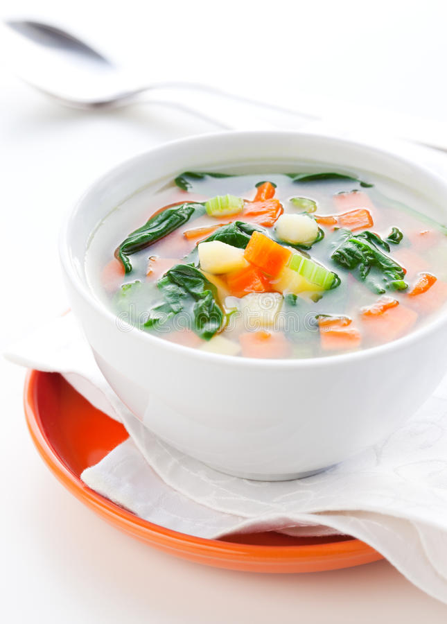 Vegetable soup. With potato,carrot,celery and spinach stock photography