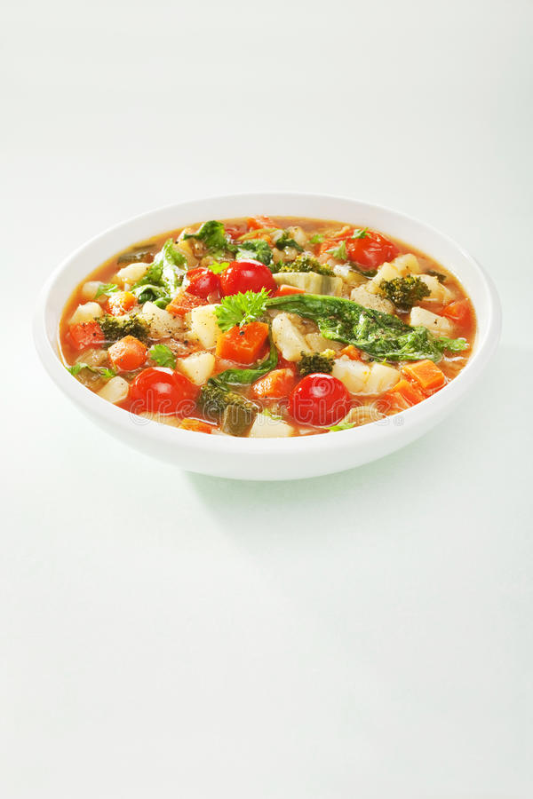 Vegetable Soup. A colourful vegetable soup in a white bowl, with copy space stock image