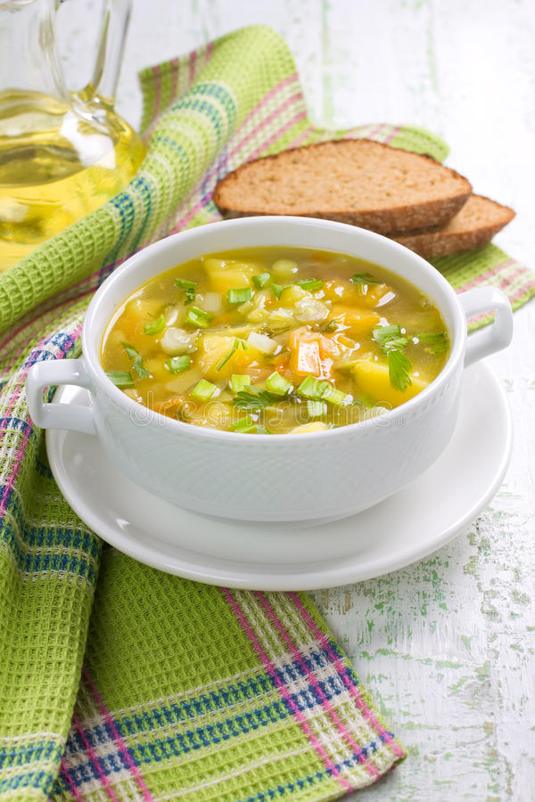 Vegetable soup. In the ceramic pot royalty free stock images