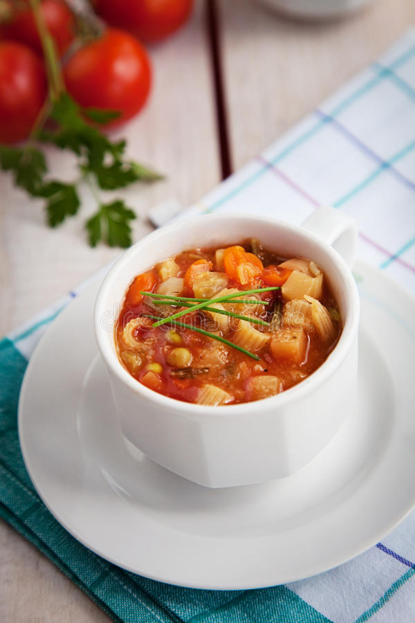 Vegetable soup. Vegetarian food. Vegetable organic soup with pasta royalty free stock image